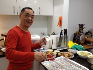President Fung dishing up the chicken wings.